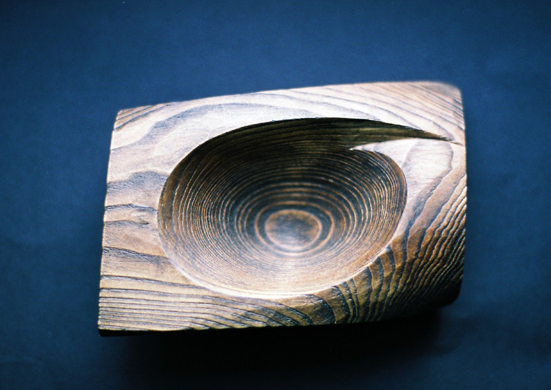 Distressed bowl-stained recovered wood.