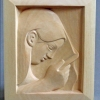 Woman with Comb - carved in Lime. sold