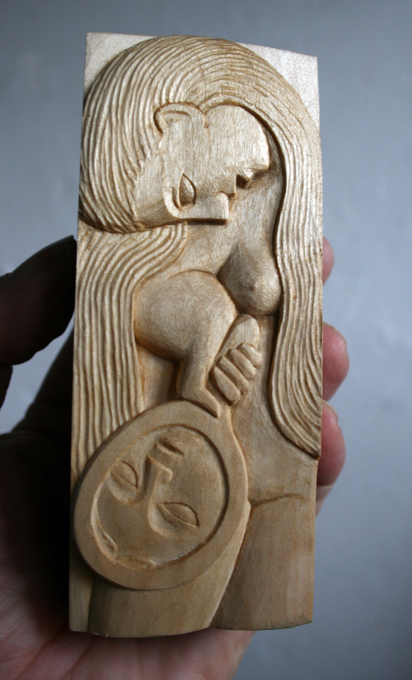 Woman with Mirror - carved in Lime.