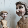 A Czech style rod marionette boy with an amorphous table top puppet.